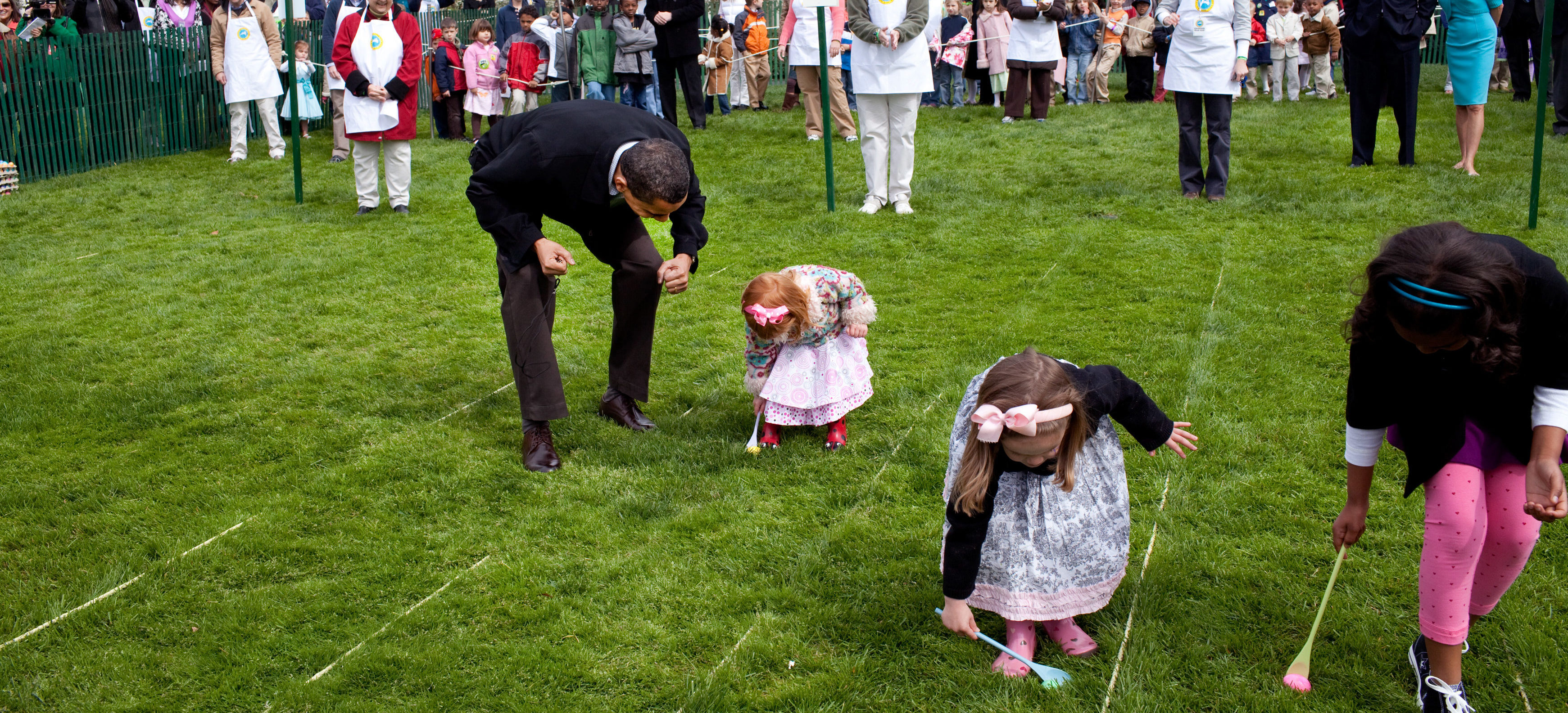 President Barack Obama cheers on a young child as she rolls her egg toward the finish line Monday, April 13, 2009, during the White House Easter Egg Roll. Official White House Photo by Pete Souza